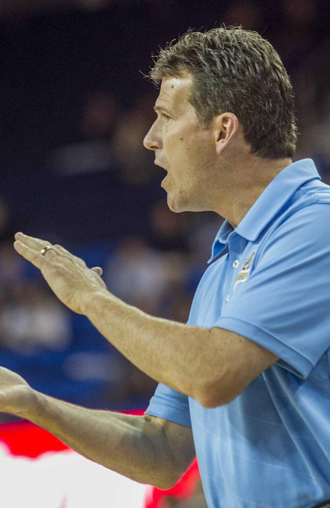 UCLA's head coach Steve Alford encourages his team against Cal State San Bernardino in the second half of an NCAA college exhibition  basketball game on Wednesday, Oct. 30, 2013, in Los Angeles. UCLA won 96-66