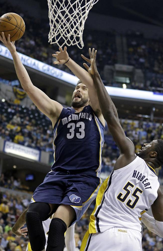 Memphis Grizzlies center Marc Gasol, left, of Spain, goes up for a shot in front of Indiana Pacers center Roy Hibbert in the first half of an NBA basketball game in Indianapolis, Monday, Nov. 11, 2013