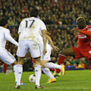Liverpool's Mario Balotelli, right, is blocked by the Real Madrid defence during the Champions League group B soccer match between Liverpool and Real Madrid at Anfield Stadium, Liverpool, England, Wednesday Oct. 22, 2014