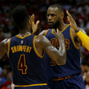 ATLANTA, GA - MAY 22: LeBron James #23 celebrates with Iman Shumpert #4 of the Cleveland Cavaliers after scoring in the second quarter against the Atlanta Hawks during Game Two of the Eastern Conference Finals of the 2015 NBA Playoffs at Philips Arena on May 22, 2015 in Atlanta, Georgia. (Photo by Kevin C. Cox/Getty Images)