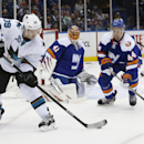 San Jose Sharks center Logan Couture (39) tries to pass as New York Islanders defenseman Calvin de Haan (44) and goalie Jaroslav Halak (41), of Slovakia, defend the crease in the first period of an NHL hockey game in Uniondale, N.Y., Thursday, Oct. 16, 20