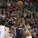 Brooklyn Nets guard Joe Johnson (7) shoots over Utah Jazz forward Richard Jefferson (24) during the first half of an NBA basketball game Wednesday, Feb. 19, 2014, in Salt Lake City The Associated Press