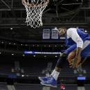 Memphis forward D.J. Stephens dunks during practice for a second-round game of the NCAA college basketball tournament at The Palace in Auburn Hills, Mich., Wednesday, March 20, 2013. Memphis plays Saint Mary's on Thursday. (AP Photo/Paul Sancya)