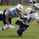 Tennessee Titans wide receiver Marc Mariani, right, can't hang onto a pass as he is defended by cornerback Marc Anthony, left, during NFL football training camp Sunday, July 27, 2014, in Nashville, Tenn The Associated Press