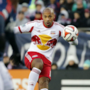 New York Red Bulls forward Thierry Henry handles the ball against the New England Revolution during the first half of the second soccer game of the MLS Eastern Conference final in Foxborough, Mass., Saturday, Nov. 29, 2014. The match ended 2-2 and New Eng