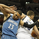 Minnesota Timberwolves guard Kevin Martin (23) gets tangled up with Memphis Grizzlies center Marc Gasol (33), of Spain, in the first half of an NBA basketball game Monday, March 24, 2014, in Memphis, Tenn The Associated Press