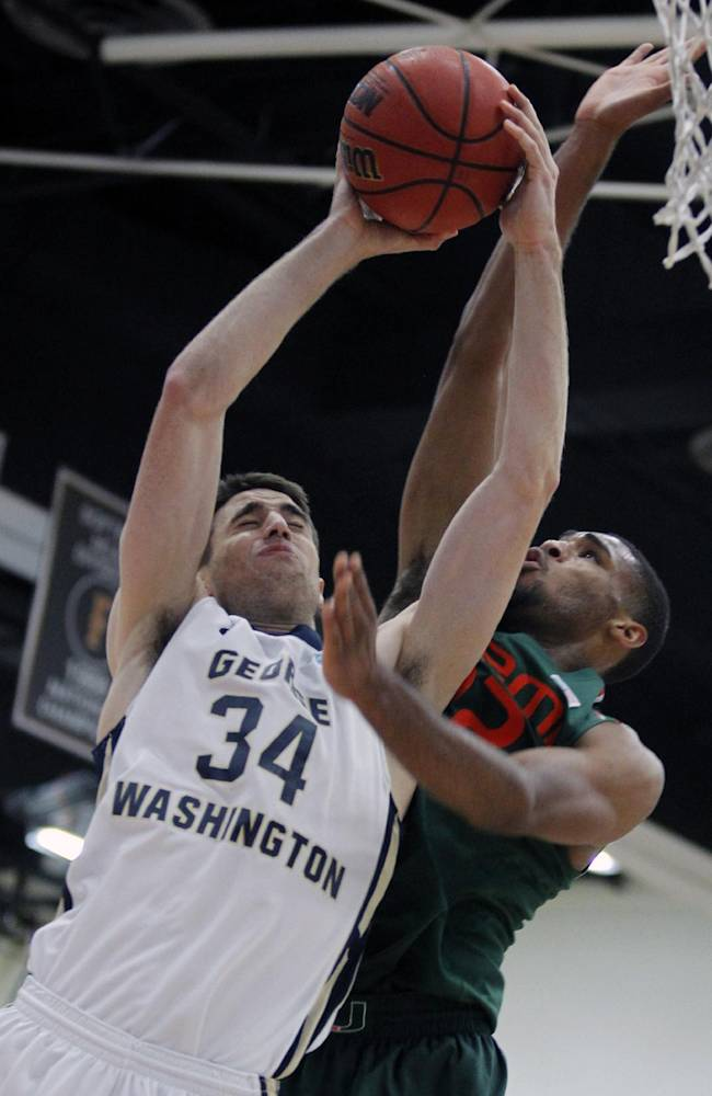 George Washington John Kopriva (34) goes up for a shot with Miami forward Donnavan Kirk, right, defending in the first half of an NCAA college basketball game at the Wooden Legacy tournament, Thursday, Nov. 28, 2013, in Fullerton, Calif