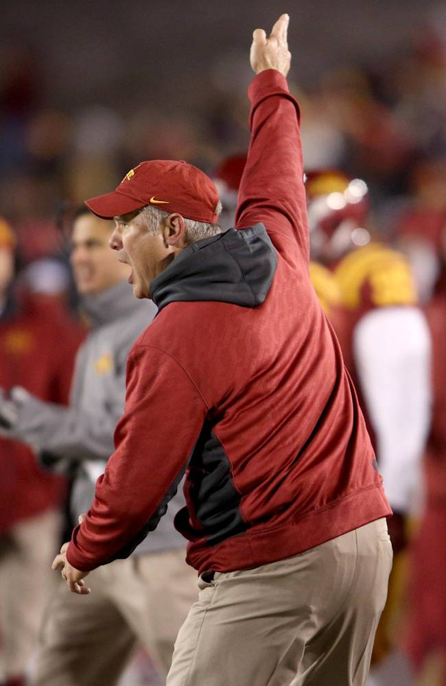 Iowa State head coach Paul Rhoads celebrates a fourth down stop by his defense during the first half of their NCAA college football game against Kansas in Ames, Iowa, Saturday, Nov. 23, 2013