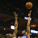 Philadelphia 76ers forward Brandon Davies (20) works to shoot around Charlotte Bobcats center Bismack Biyombo (0) during the second half of an NBA basketball game in Charlotte, N.C., Saturday, April 12, 2014 The Associated Press