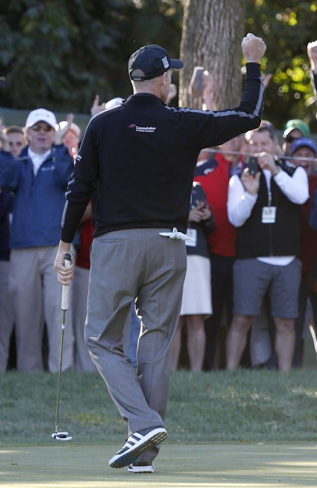 Jim Furyk pumps his fist after posting a 59, tying the PGA single round record, during the second round of the BMW Championship golf tournament at Conway Farms Golf Club in Lake Forest, Ill., Friday, Sept. 13, 2013