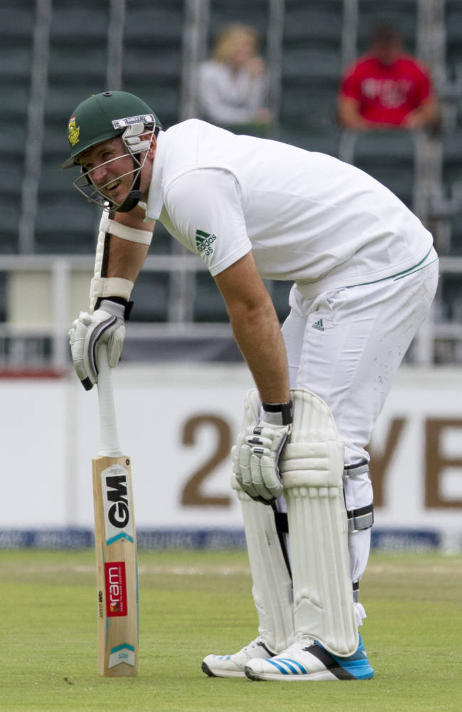 South Africa's captain Graeme Smith holds his leg in pain after being hit by a ball, during the second day of their cricket test match against India at Wanderers stadium in Johannesburg, South Africa, Thursday, Dec. 19, 2013