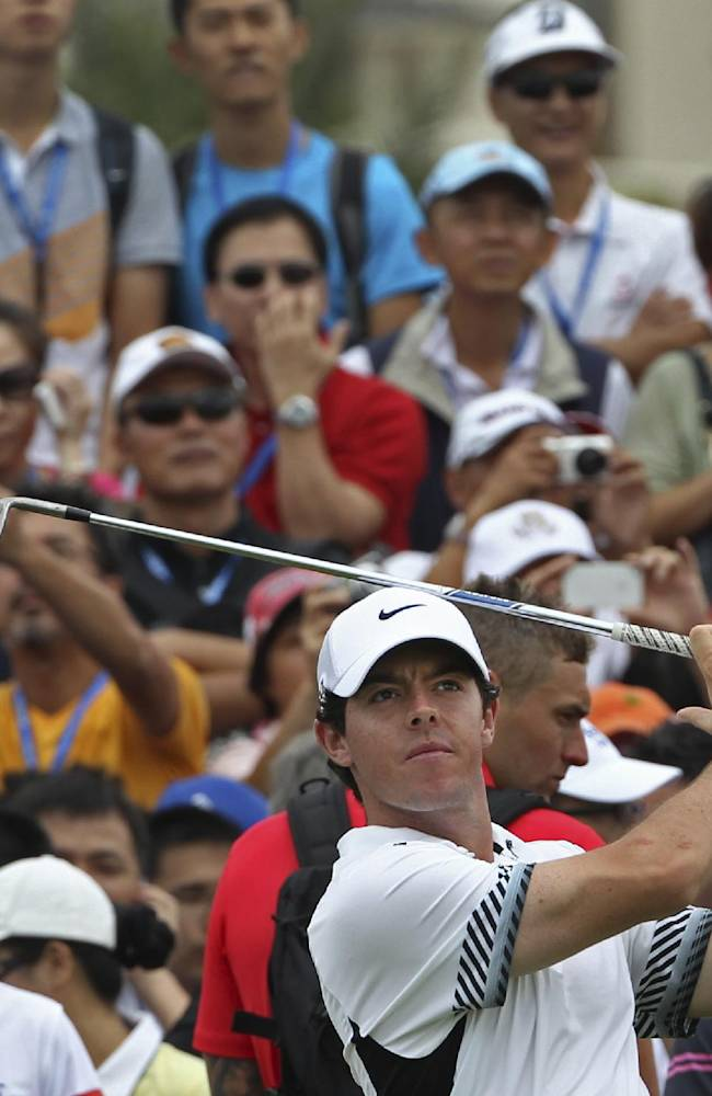 Rory Mcllory of Northern Ireland tees off during an exhibition golf match against Tiger Woods of the United States in Haikou, in southern China's island province Hainan, Monday, Oct. 28, 2013