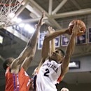 Gonzaga's Angel Nunez (2), right, takes a jump shot against SMU's Yanick Moreira (2) and Ben Moore during the first half of an NCAA college basketball game in Spokane, Wash., Monday, Nov. 17, 2014. (AP Photo/Young Kwak)