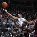 Michigan State's Marvin Clark Jr. (0) and Texas Southern's Nevin Johnson (24) reach for a rebound during the first half of an NCAA college basketball game, Saturday, Dec. 20, 2014, in East Lansing, Mich. (AP Photo/Al Goldis)