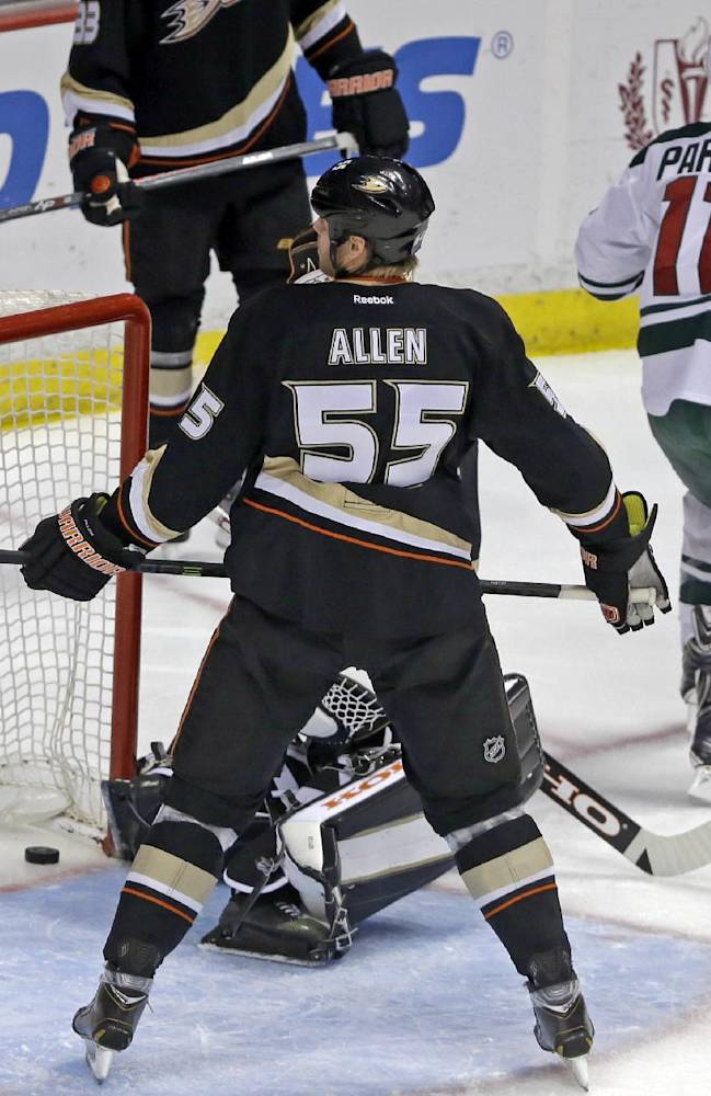 Minnesota Wild left winger Zach Parise (11) celebrates a goal by right winger Jason Pominville, not shown, over Anaheim Ducks goalie Jonas Hiller (1), of Switzerland, rear, and defenseman Bryan Allen (55) in the first period of an NHL hockey game in Anaheim, Calif.,Tuesday, Jan. 28, 2014.  The Wild won, 4-2