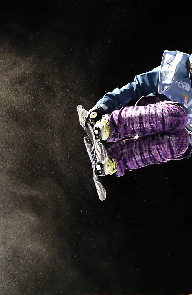 Japan's Shuri Terada flies above the lip of the halfpipe during the World Cup U.S. Grand Prix freestyle skiing qualifications on Thursday, Dec. 19, 2013, in Frisco, Colo