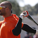 Baltimore Orioles' Nick Markakis stretches as he waits his turn in the batting cage before an exhibition spring training baseball game against the Boston Red Sox in Sarasota, Fla., Saturday, March 8, 2014 The Associated Press