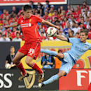 IMAGE DISTRIBUTED FOR GUINNESS INTERNATIONAL CHAMPIONS CUP - Midfielder Bruno Zuculini (36) of Manchester City and defender Martin Kelly (34) of Liverpool FC battle for a loose ball during the Guinness International Champions Cup on Wednesday, July 30, 20
