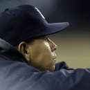 New York Yankees' Alex Rodriguez watches from the dugout in the sixth inning during Game 3 of the American League championship against the Detroit Tigers series Tuesday, Oct. 16, 2012, in Detroit. (AP Photo/Paul Sancya )