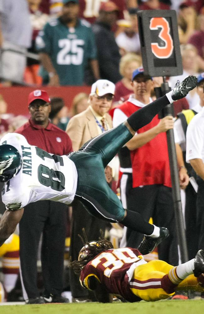 Philadelphia Eagles wide receiver Jason Avant (81) dives for the first down during the second half of an NFL football game against the Washington Redskins, Monday, Sept. 9, 2013, in Landover, Md