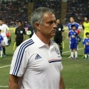 Chelsea's manager Jose Mourinho walks on to the pitch before the soccer match against Thailand's Singha All Star at Rajamangala national stadium in Bangkok, Thailand Wednesday, July 17, 2013. (AP Photo/Apichart Weerawong)