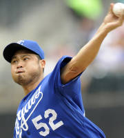 Kansas City Royals pitcher Bruce Chen delivers the ball to the New York Mets during the first inning of an interleague baseball game Saturday, Aug. 3, 2013 at Citi Field in New York. (AP Photo/Bill Kostroun)