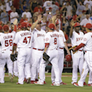 The Los Angeles Angels celebrate their team's 8-1 win against the Seattle Mariners in a baseball game Monday, Sept. 15, 2014, in Anaheim, Calif. (AP Photo/Jae C. Hong)