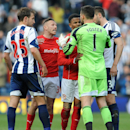 Tempers flare between Cardiff's Craig Bellamy, second left, and West Brom goalkeeper Ben Foster after the final whistle during the English Premier League soccer match between West Bromwich Albion and Cardiff City at Hawthorns Stadium in West Bromwich, Eng