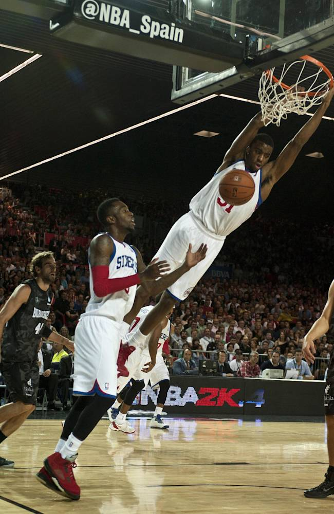 Philadelphia 76ers' Hollis Thompson, center, dunks against Bilbao Basket during the NBA Global basketball game in Bilbao northern Spain on Sunday, Oct. 6, 2012
