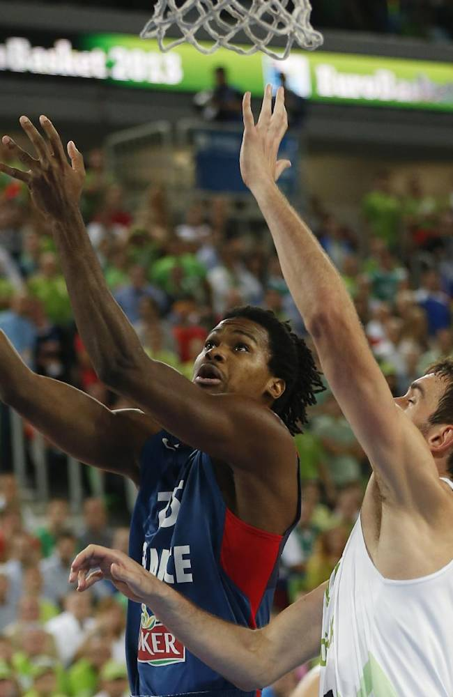 Slovenia's Mirza Begic, right, tries to block France's Mickael Gelabale, left, during their EuroBasket European Basketball Championship quarterfinal match in Ljubljana, Slovenia, Wednesday, Sept. 18, 2013