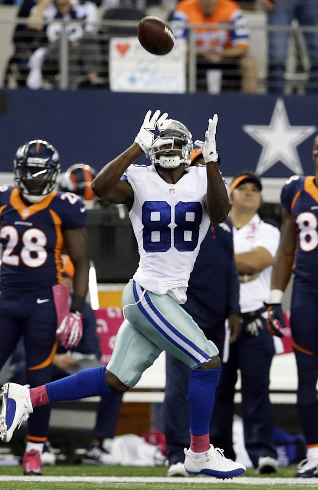 Dallas Cowboys wide receiver Dez Bryant makes an 80-yard reception from Tony Romo during the fourth quarter of an NFL football game against the Denver Broncos, Sunday, Oct. 6, 2013, in Arlington, Texas. The Broncos won 51-48