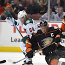 Anaheim Ducks center Ryan Getzlaf, right, and Minnesota Wild center Mikael Granlund, of Finland, vie for the puck following a faceoff during the third period an NHL hockey game, Friday, Oct. 17, 2014, in Anaheim, Calif. The Ducks won 2-1 The Associated Pr