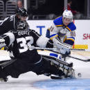 St. Louis Blues right wing Vladimir Tarasenko, right, of Russia, tries to get a shot in against Los Angeles Kings goalie Jonathan Quick during the first period of an NHL hockey game, Thursday, Dec. 18, 2014, in Los Angeles. (AP Photo/Mark J. Terrill)