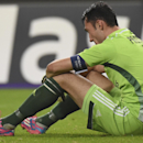 Anderlecht's goalkeeper Silvio Proto sits on the pitch after losing the Group D Champions League match with a 2-1 score against Arsenal at Constant Vanden Stock Stadium in Brussels, Belgium, Wednesday Oct. 22, 2014