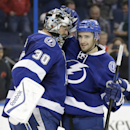 Tampa Bay Lightning goalie Ben Bishop (30) celebrates with center Cedric Paquette (13) after the team defeated the Detroit Red Wings 5-1 during an NHL hockey game Thursday, Jan. 29, 2015, in Tampa, Fla The Associated Press