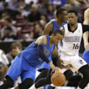 Dallas Mavericks guard Monta Ellis, left, drives against Sacramento Kings guard Ben McLemore during the third quarter of an NBA basketball game, Sunday, April 6, 2014, in Sacramento, Calif. The Mavericks won 93-91 The Associated Press