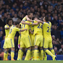 Chelsea's Branislav Ivanovic is swamped by jubilant teammates as he celebrates after scoring against Everton during their English Premier League soccer match at Goodison Park Stadium, Liverpool, England, Saturday Aug. 30, 2014
