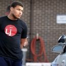 In this photo provided by The Daily Reveille, former LSU cornerback Tyrann Mathieu is walked to a police car at Baton Rouge Police Department Second District Police Station bound for East Baton Rouge Parish prison after he and former LSU teammates Jordan Jefferson, Derrick Bryant and Karnell Hatcher were found in The Venue at Northgate, an apartment complex in Baton Rouge, with 18 grams of marijuana, Thursday, Oct. 25, 2012 (AP Photo/The Daily Reveille, Catherine Threlkeld)