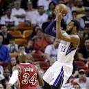 Sacramento Kings' Derrick Williams (13) shoots over Miami Heat's Ray Allen (34) in the first half of an NBA basketball game, Friday, Dec. 20, 2013, in Miami. (AP Photo/Lynne Sladky)
