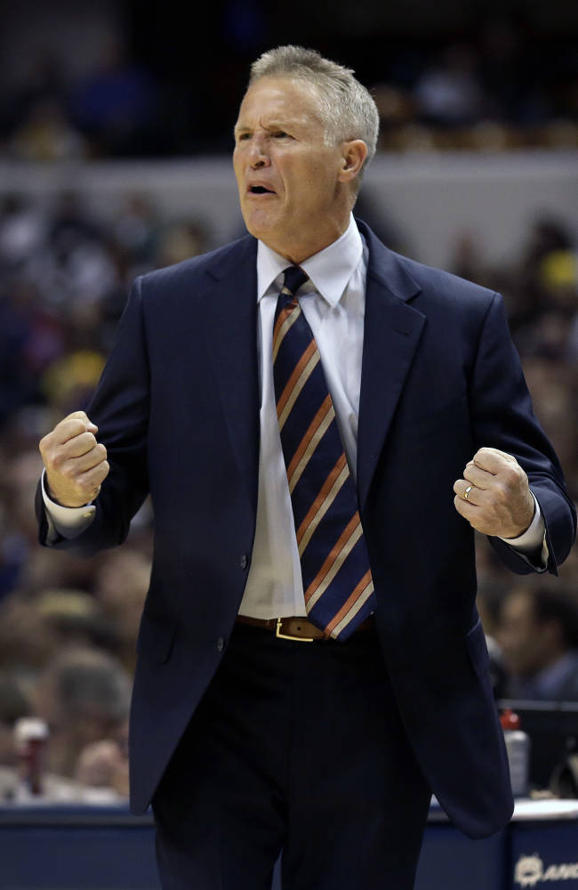 Philadelphia 76ers head coach Brett Brown questions an officials call during the second half of an NBA basketball game against the Indiana Pacers in Indianapolis, Saturday, Nov. 23, 2013. The Pacers won 106-98