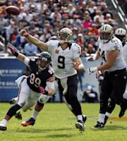 New Orleans Saints quarterback Drew Brees (9) throws a pass as Chicago Bears defensive end Shea McClellin (99) pressures him during the second half of an NFL football game, Sunday, Oct. 6, 2013, in Chicago.(AP Photo/Charles Rex Arbogast)