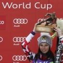 First placed Anna Fenninger of Austria celebrates with trophy after the women's Super G event of the Alpine Skiing World Cup in Bansko, March 2, 2015.                   REUTERS/Stoyan Nenov