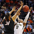 Baylor guard Odyssey Sims (0) shoots as Oklahoma State center Kendra Suttles (31) defends in the second half of an NCAA college basketball game in the semifinals of the Big 12 Conference women's college tournament in Oklahoma City, Sunday, March 9, 2014. Baylor won 65-61. (AP Photo/Sue Ogrocki)