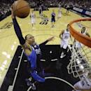 Dallas Mavericks' Shawn Marion (0) drives to the basket over San Antonio Spurs' Tony Parker (9), of France, during the first half of Game 2 of the opening-round NBA basketball playoff series on Wednesday, April 23, 2014, in San Antonio. (AP Photo/Eric Gay)