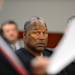 O.J. Simpson looks over at his lawyer Tom Pitaro during an evidentiary hearing in Clark County District Court on May 17, 2013 in Las Vegas. Simpson, who is currently serving a nine-to-33-year sentence in state prison as a result of his October 2008 conviction for armed robbery and kidnapping charges, is using a writ of habeas corpus to seek a new trial, claiming he had such bad representation that his conviction should be reversed. (AP Photo/Ethan Miller, Pool)