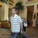 Detroit Tigers manager Brad Ausmus leaves after the conclusion of baseball's winter meetings in Lake Buena Vista, Fla., Thursday, Dec. 12, 2013 The Associated Press