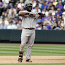 San Francisco Giants' Pablo Sandoval reacts after committing the final out with the bases loaded against the Colorado Rockies in the fifth inning of a baseball game in Denver on Wednesday, April 23, 2014 The Associated Press