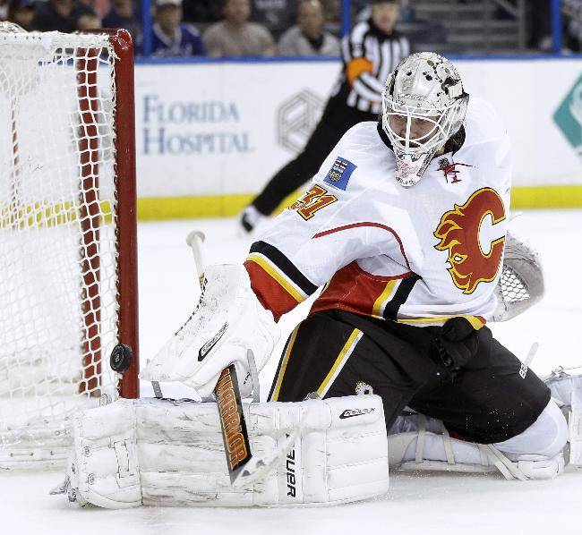 Calgary Flames goalie Karri Ramo (31), of Finland, makes a save on a shot by the Tampa Bay Lightning during the second period of an NHL hockey game on Thursday, April 3, 2014, in Tampa, Fla