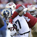 St. Louis Rams' Matt Giordano (27) is tackled for a loss by San Francisco 49ers' Anthony Dixon on a fake punt play during the fourth quarter of an NFL football game in San Francisco, Sunday, Dec. 1, 2013 The Associated Press