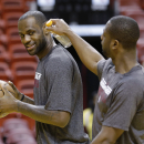 Miami Heat shooting guard Dwyane Wade, right, jokes with small forward LeBron James as he takes a shot during NBA basketball practice, Wednesday, June 19, 2013 at the American Airlines Arena in Miami. The Heat host the San Antonio Spurs in Game 7 of the NBA Finals on Thursday. (AP Photo/Wilfredo Lee)